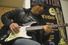 joe Satriani rocking out on a cheap guitar